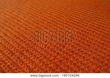 Close-up of bright orange handmade rib knit fabric