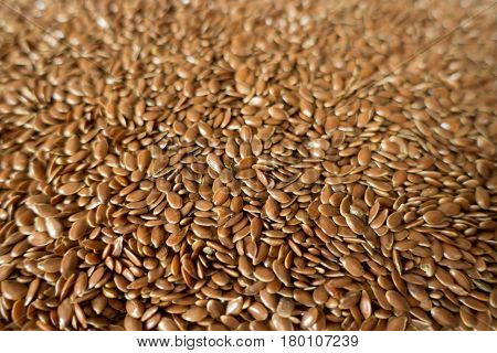 Lots of raw organic flax seeds (close-up)