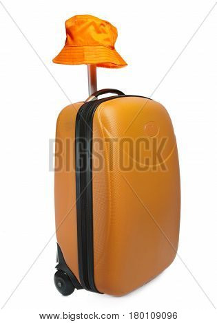Orange suitcase for travel and a hat