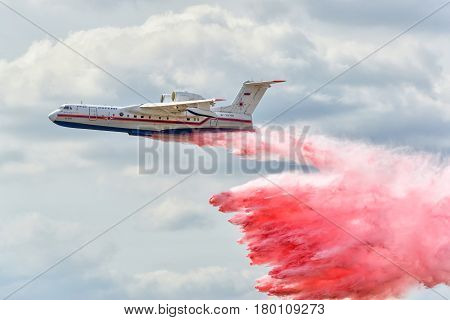 MOSCOW REGION - AUGUST 28, 2015: The Russian EMERCOM amphibious aircraft Be-200 demonstrated fire fightingat at the International Aviation and Space Salon (MAKS) in Zhukovsky.