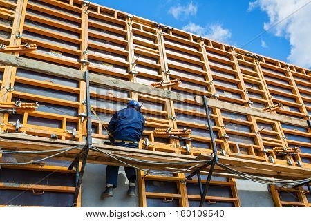 MOSCOW - APRIL 10: Construction site worker on formwork on april 10, 2014 in Moscow, Russia. Urban construction is at a faster pace in Russia.