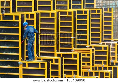 MOSCOW - MAY 6: Construction site worker on may 6 2014 in Moscow, Russia. Urban construction is at a faster pace in Russia.