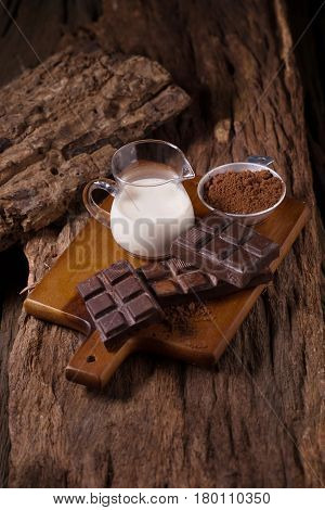 Chocolate and Milk on wooden background. healthy drink