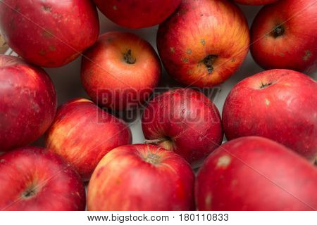 Imperfect red organic apples directly from above