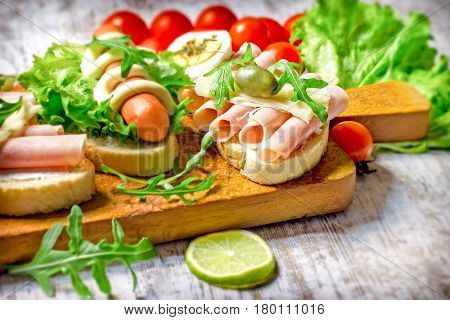 Healthy and delicious sandwiches - sandwich with ham and sandwich with hot dog-frankfurter