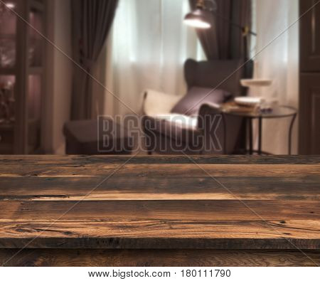 Senior citizen blur living room interior wooden table in front