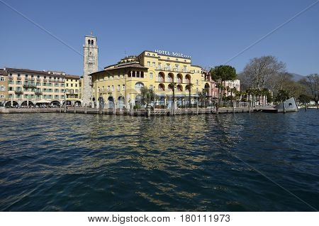 Riva del Garda Italy - March 28 2017: Hotel Sun and Apponale tower in sunny day in early spring