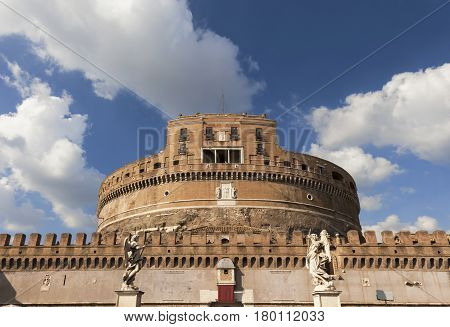 Ancient Castel Sant'Angelo in the center of Rome with marble angel statues and beautiful clouds