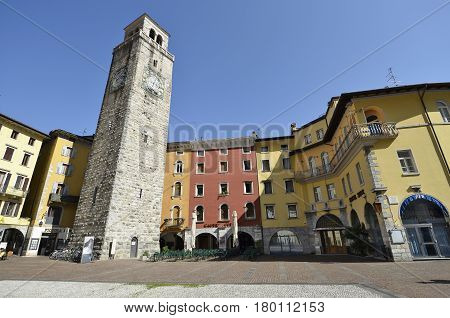 Riva del Garda Italy - March 28 2017: Piazza III November and Apponale tower in sunny day in early spring