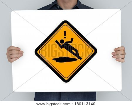 Studio Shoot Holding Banner with Slip Caution Sign