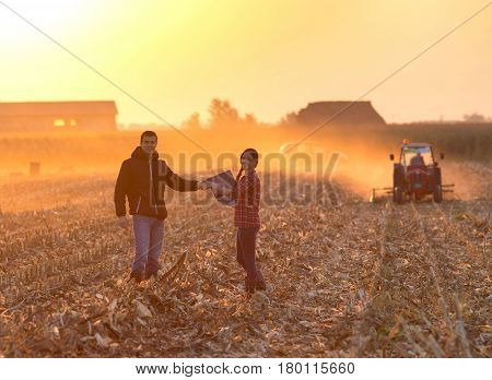 Farmers Shaking Hnds At Sunset
