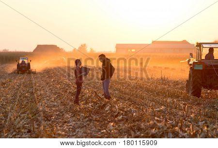 Farmers Talking On Field