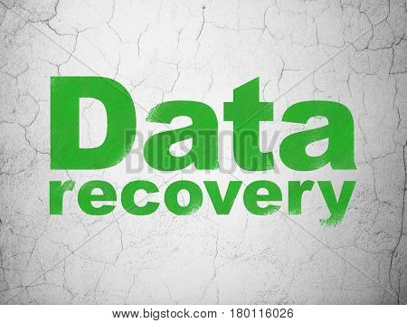 Information concept: Green Data Recovery on textured concrete wall background