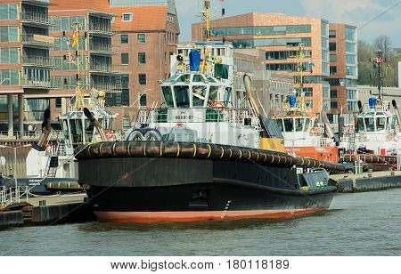 Hamburg, Germany - April 02, 2017: Tugging on the same to haul a container ship on April 02, 2017, in the Germany Hamburg