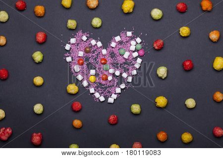 Colorful Dragee Sweets, Marshmallow, Zephyr And Sprinkles In Heart Shape