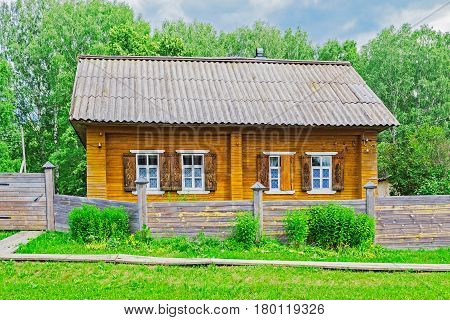 Wooden russian village house on a summer day