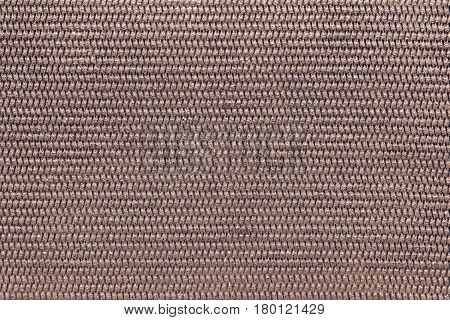 the abstract textured background of brown color of polymeric material or synthetic fabric with a corrugated symmetric pattern and with small droplets of water
