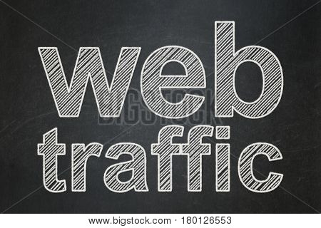 Web design concept: text Web Traffic on Black chalkboard background