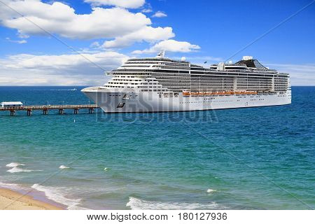 Luxury Cruise Ship at pier on summer day