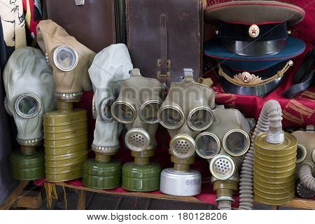 Kiev Ukraine - June 04 2016: Gas masks and a Soviet military uniform on the flea market counter on Andreevsky Descent