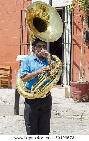 OAXACA, MEXICO, MARCH 10, 2017: Trombonist. Street musician in Oaxaca, Mexico