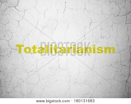 Politics concept: Yellow Totalitarianism on textured concrete wall background