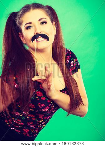 Happy Woman Holding Fake Moustache On Stick