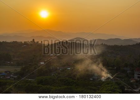 Mountain soft fog scenic sunset at Chaingrai Thailand. Mountain hill viewpoint scenic landmark .