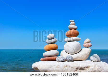 Double Rock Zen on the background of summer sea. Concept of harmony and balance