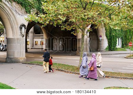 Zurich Switzerland - September 2 2016: Traditional muslim family with husband and a child and three women in hijabs in the streets of Zurich Switzerland