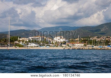 Landscape of seashore with beautiful hills and hotels in Sardinia Italy, Sardegna
