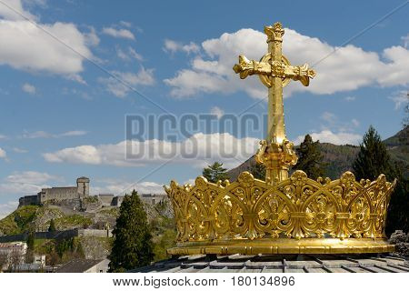 The gilded crown ad cross in Lourdes France
