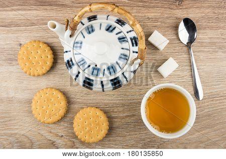 Tea, Round Cookies, Teapot, Lumpy Sugar And Spoon