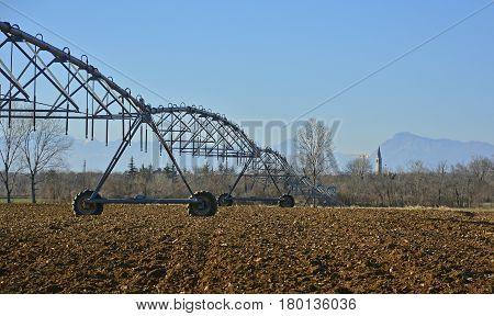 A crop irrigator in a dry winter field in Friuli Venezia Giulia north east Italy