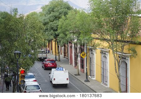 OAXACA, MEXICO - MARCH 11, 2017 : Street view in Oaxaca, Mexico with cars and colorful houses on March 11, 2017.