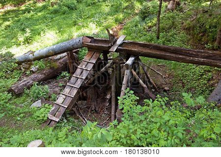 Pipe and the wooden trough in the forest, Montenegro