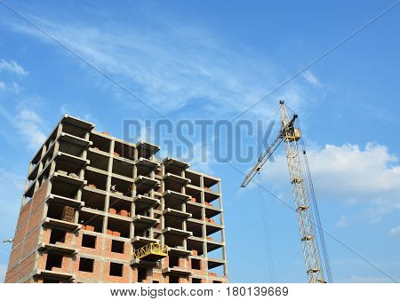 Tower Cranes Work. Tower Crane Picture with copy space. Tower Crane and building construction site with contractor on the top