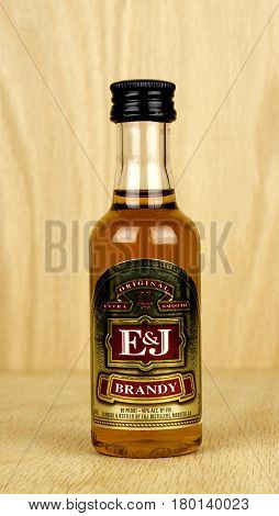 RIVER FALLS,WISCONSIN-APRIL 02,2017: A bottle of E&J brand Brandy with a wood background.