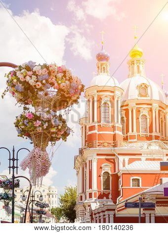 The church of Saint Clement of Rome in Moscow with flowers on the foreground.