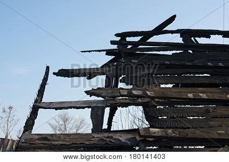 Closeup of remains of burnt wooden wall