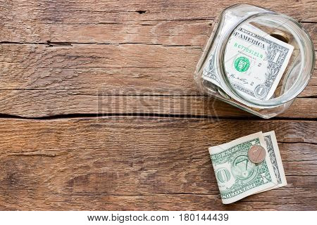 Jar For Fundraising And Money On A Wooden Background
