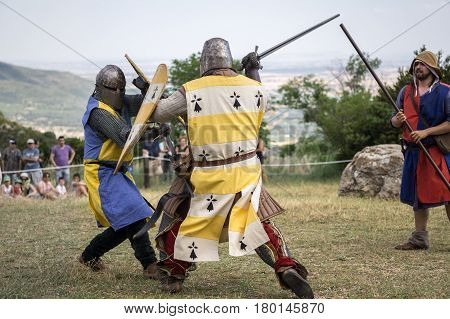 Loarre, Spain - July 09, 2016: Medieval reenactment with costumed characters and medieval armor with chainmail, helmet swords and shields. Battle knight demonstration and recreation