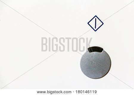 Closeup power button with symbol above it on white background
