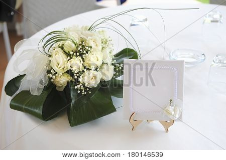 Ticket booking for a table with a separate written to the spouses left a bouquet of flowers to mean a celebratory event