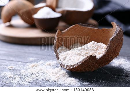 Coconut flour in rind on wooden table