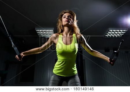 Girl in the gym doing exercises in the squat rack looking forward