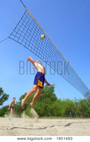 Playing Beach Volleyball - Fat Man Jumps High To Spike The Ball