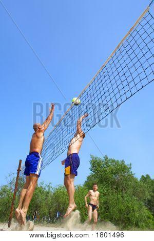 Three Men Playing Beach Volleyball - Fat Man Versus Balding One