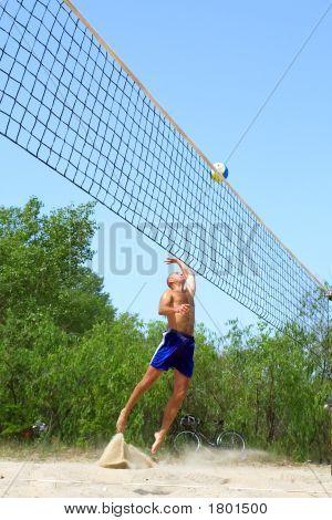 Balding Man Plays Beach Volleyball - Beautiful Pose In Jump