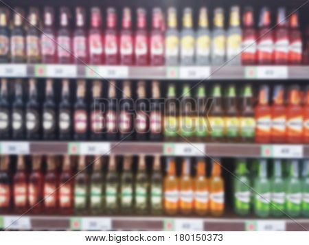 blurred photo, Blurry image, Various liquor brands on the shelves, background